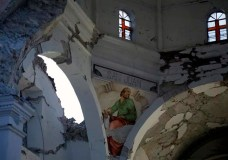 The Santiago Apostol church stands damaged after the 7.1 earthquake in the town of Atzala in Puebla state, Mexico, Wednesday Sept. 20, 2017. According to family members of the 11 people who died inside the church during Tuesday's quake, the roof collapsed during a Mass held to baptize a two-year-old girl, and the only people who survived were the baby's father, the priest and the priest's assistant. (AP Photo/Pablo Spencer)