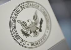 The U.S. Securities and Exchange Commission logo adorns an office door at the SEC headquarters in Washington, June 24, 2011. The database is emerging alongside a new program by the FBI's criminal profiling group in Quantico, Virginia, that is creating a series of behavioral composites to help agents investigate white collar crime. The more systematic approach by the SEC and FBI comes in response to the growth and complexity of financial crimes in recent years. Picture taken June 24, 2011. To match Special Report SEC/INVESTIGATIONS  REUTERS/Jonathan Ernst    (UNITED STATES - Tags: CRIME LAW POLITICS BUSINESS) - GM1E77R1S1U01