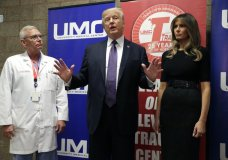 President Donald Trump talks as first lady Melania Trump and surgeon Dr. John Fildes listens at the University Medical Center after Trump met with survivors of the mass shooting Wednesday, Oct. 4, 2017, in Las Vegas. (AP Photo/Evan Vucci)