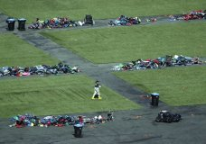 A member of the FBI walks among piles of personal items at the scene of a mass shooting Friday, Oct. 6, 2017, in Las Vegas. Stephen Paddock opened fire on an outdoor music concert on Sunday killing dozens and injuring hundreds. (AP Photo/John Locher)