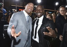 "FILE - In this April 1, 2015, file photo, Dwayne Johnson, left, and Tyrese Gibson arrive at the premiere of ""Furious 7"" at the TCL Chinese Theatre IMAX in Los Angeles. Tyrese posted on Instagram Thursday, Oct. 5, 2017, that Johnson was a ""clown"" for agreeing to star in a spinoff film in the ""Fast & Furious"" franchise. (Photo by John Shearer/Invision/AP, File )"