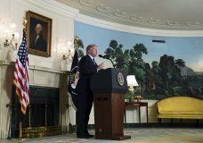 """President Donald Trump speaks about Iran from the Diplomatic Reception Room at the White House in Washington, Friday, Oct. 13, 2017. Trump says Iran is not living up to the """"spirit"""" of the nuclear deal that it signed in 2015, and announced a new strategy in the speech. He says the administration will impose additional sanctions on the regime to block its financing of terrorism. (AP Photo/Susan Walsh)"""