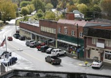 This Monday, Oct. 9, 2017 photo shows traffic moving through downtown Pound, Va. People in Virginia's coal country still love President Donald Trump but are unenthusiastic about his pick to be the next governor of Virginia. Ed Gillespie is a Washington insider who Trump has endorsed in the upcoming Virginia gubernatorial contest. (AP Photo/Steve Helber)
