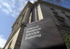 FILE - In this photo March 22, 2013 file photo, the exterior of the Internal Revenue Service (IRS) building in Washington. Contrary to widespread perceptions, the IRS still appears to be enforcing the unpopular Obama-era requirement that most people carry health insurance or risk a fine. The agency says it will automatically reject electronic returns for tax year 2017 that don't specify if the taxpayer had health insurance. (AP Photo/Susan Walsh, File)