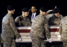 """FILE- In this Oct. 29, 2009, file photo, President Barack Obama, center, salutes as an Army carry team carries the transfer case containing the remains of Sgt. Dale R. Griffin of Terre Haute, Ind., during a dignified transfer event at Dover Air Force Base, Del. President Donald Trump is claiming his predecessors did not sufficiently honor the nation's fallen. Obama's office says Trump is """"unequivocally wrong,"""" and says Obama engaged families of the fallen and wounded warriors through his presidency — through calls, letters, visits to Arlington National Cemetery, regular meetings with Gold Star families and more. (AP Photo/Pablo Martinez Monsivais, File)"""