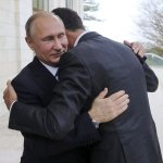 Syria's Assad Travels To Russia, Meets With Putin