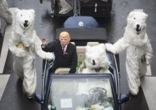 Demonstrators costumed as U.S. President Donald Trump and polar bears protest against the climate change during climate conference COP in Bonn, western Germany, Saturday, Nov. 11, 2017. (Bernd Thissen/dpa via AP)