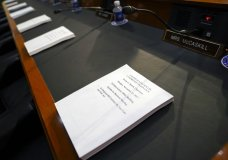 Copies of the Finance Committee Markup are placed for each member of the Senate Finance Committee before the start of the hearing as the tax-writing panel begins work on overhauling the nation's tax code, on Capitol Hill in Washington, Monday, Nov. 13, 2017. The legislation in the House and Senate carries high political stakes for President Donald Trump and Republican leaders in Congress, who view passage of tax cuts as critical to the GOP's success at the polls next year. (AP Photo/Pablo Martinez Monsivais)