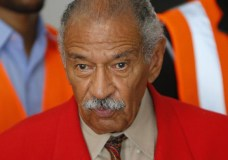 FILE - In this July 7, 2014 file photo, U.S. Rep. John Conyers, D-Mich., speaks in Detroit. The longtime Michigan Congressman on Tuesday, Nov. 21, 2017, denied settling a sexual harassment complaint in 2015 from a woman who alleged she was fired from his Washington staff because she rejected his sexual advances. (AP Photo/Paul Sancya)