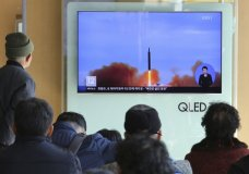"""People watch a TV screen showing file footage of North Korea's missile launch at Seoul Railway Station in Seoul, South Korea, Tuesday, Nov. 21, 2017. U.S. President Donald Trump announced Monday the U.S. is putting North Korea's """"murderous regime"""" on America's terrorism blacklist, despite questions about Pyongyang's support for international attacks beyond the assassination of its leader's half brother in February. (AP Photo/Ahn Young-joon)"""