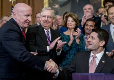 Speaker of the House Paul Ryan, R-Wis., right, shakes hands after presenting a pen to House Ways and Means Committee Chairman Kevin Brady, R-Texas, left, as Senate Majority Leader Mitch McConnell, R-Ky., second from left, watches after signing the final version of the GOP tax bill during an enrollment ceremony at the Capitol in Washington, Thursday, Dec. 21, 2017. (AP Photo/Andrew Harnik)