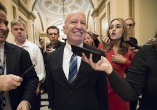 House Ways and Means Committee Chairman Kevin Brady, R-Texas, is pursued by reporters in the Capitol after signing the conference committee report to advance the GOP tax bill, in Washington, Friday, Dec. 15, 2017. (AP Photo/J. Scott Applewhite)