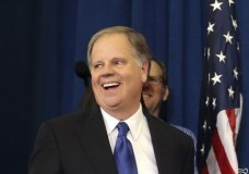 Democrat Doug Jones smiles as he arrives to speak Tuesday, Dec. 12, 2017, in Birmingham, Ala. In a stunning victory aided by scandal, Jones won Alabama's special Senate election, beating back history, an embattled Republican opponent and President Donald Trump, who urgently endorsed GOP rebel Roy Moore despite a litany of sexual misconduct allegations. (AP Photo/John Bazemore)