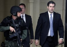 FILE - In this Monday, Dec. 5, 2016, file photo, former South Carolina police officer Michael Slager, right, walks from the Charleston County Courthouse under the protection of the Charleston County Sheriff's Department after a mistrial was declared for his trial in Charleston, S.C. l Slager is in court Monday, Dec. 4, 2017, facing a possible life sentence for the April 2015 shooting death of Walter Scott. The foot chase and shooting were captured by a bystander on cellphone video that was seen by millions online. Slager pleaded guilty in May to violating Scott's civil rights. A state jury deadlocked last year on murder charges, which were dropped as part of his federal plea deal. (AP Photo/Mic Smith, File)
