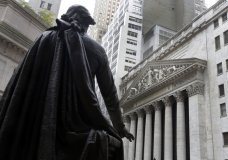 FILE - In this Oct. 2, 2014, file photo, the statue of George Washington on the steps of Federal Hall faces the facade of the New York Stock Exchange. Stocks are opening broadly higher on Wall Street, Wednesday, Dec. 20, 2017, led by gains in banks and industrial companies. (AP Photo/Richard Drew, File)