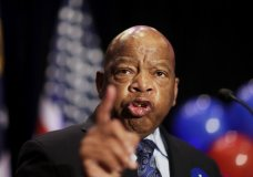 "FILE- In this June 20, 2017 file photo, Rep. John Lewis, D-Ga., speaks at an election night party for Democratic candidate for 6th congressional district Jon Ossoff in Atlanta. Lewis announced Thursday, Dec. 7 that he won't speak at the opening of Mississippi civil rights and history museums on Saturday, saying it's an ""insult"" that President Donald Trump will attend. (AP Photo/David Goldman, File)"