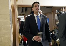 House Speaker Paul Ryan of Wis., center, arrives for a meeting of House Republicans on Capitol Hill in Washington, Tuesday, Dec. 19, 2017. Republicans are ready to ram a $1.5 trillion tax package through Congress, giving President Donald Trump the legislative win he desperately wants. (AP Photo/Susan Walsh)