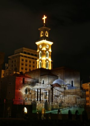 The Saint Georges Cathedral, illuminated by a giant projection of the Church of Holy Sepulchre, in down town Beirut, Lebanon, Thursday, Dec. 7, 2017. A number of U.S. allies in the Middle East are condemning the Trump administration's decision to recognize Jerusalem as the capital of Israel, with the United Arab Emirates, Kuwait, Qatar and Saudi Arabia urging Washington to reconsider and reverse the announcement. (AP Photo/Bilal Hussein)