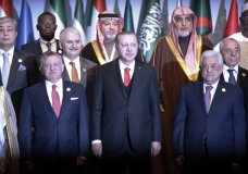 "Turkey's President Recep Tayyip Erdogan, centre, flanked by Jordan's King Abdullah II, left and Palestinian President Mahmoud Abbas, right, poses for photographs wth other leaders during a photo-op prior to the opening session of the Organisation of Islamic Cooperation in Istanbul, Wednesday, Dec. 13, 2017. Leaders and high-ranking officials of Muslim countries met in Istanbul to discuss the U.S. recognition of Jerusalem as Israel's capital. Erdogan_ term president of OIC, the umbrella organisation of 57-members, has been vehemently critical of the U.S. move and said the leaders would relay a ""strong message."" (AP Photo/Lefteris Pitarakis)"
