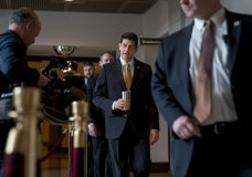 House Speaker Paul Ryan of Wis., center, walks to the Capitol Building from the Capitol Visitor's Center, Thursday, Jan. 18, 2018, in Washington. (AP Photo/Andrew Harnik)