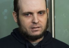 FILE- In this Oct. 31, 2017, file photo, Joshua Boyle speaks to the media after arriving at the Pearson International Airport in Toronto. A lawyer for Boyle, a Canadian man recently freed with his American wife and children after years of being held hostage in Afghanistan, says his client has been arrested and faces at least a dozen charges including sexual assault. Attorney Eric Granger said Tuesday, Jan. 2, 2017, that Boyle also faces assault and forcible confinement charges. (Nathan Denette/The Canadian Press via AP)