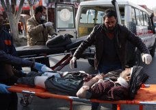 People help carry an injured man to the hospital following a suicide attack in Kabul, Afghanistan, Saturday Jan. 27, 2018. Authorities say suicide car bomber killed dozens of people and wounded over 100 in an attack claimed by the Taliban in the Afghan capital Kabul, authorities said. (AP Photo/ Rahmat Gul)