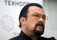 "FILE - In this Sept. 22, 2015, file photo, actor Steven Seagal speaks at a news conference, while attending an opening ceremony for a research and development center in Moscow, Russia. A once-aspiring actress has alleged Seagal raped her at a wrap party for the film ""On Deadly Ground,"" claiming he undressed her and assaulted her on his bed while she focused on a photo of Seagal's wife on the nightstand. Regina Simons called the alleged assault ""very predatory, very aggressive and traumatizing"" during an interview that aired Friday, Jan. 26, 2018 on ""Megyn Kelly Today."" She was 18 at the time. (AP Photo/Ivan Sekretarev, File)"