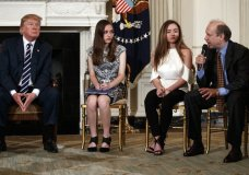 "From left, President Donald Trump, Marjory Stoneman Douglas High School student students Carson Abt, and Ariana Klein, listen as Carson's father Frederick Abt, speaks during a listening session with high school students, teachers, and others in the State Dining Room of the White House in Washington, Wednesday, Feb. 21, 2018. In the aftermath of yet another mass school shooting, Trump says that if one of the victims, a football coach, had been armed ""he would have shot and that would have been the end of it."" Revisiting an idea he raised in his campaign, Trump's comments in favor of allowing teachers to be armed come as lawmakers in several states are wrestling with the idea, including in Florida, where the 17 most recent school shooting victims are being mourned.(AP Photo/Carolyn Kaster)"
