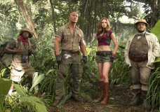 "FILE - This file image released by Sony Pictures shows Kevin Hart, from left, Dwayne Johnson, Karen Gillan and Jack Black in ""Jumanji: Welcome to the Jungle."" According to studio estimates Sunday, ""Jumanji"" grossed $11 million over the weekend. (Frank Masi/Sony Pictures via AP, File)"