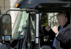 FILE - In this March 23, 2017, file photo, President Donald Trump gestures while sitting in an 18-wheeler truck while meeting with truckers and CEOs regarding healthcare on the South Lawn of the White House in Washington. President Donald Trump is putting the brakes on attempts to address dangerous transportation safety problems from speeding tractor-trailers to sleepy railroad engineers as part of his quest to roll back regulations across the government.1 (AP Photo/Andrew Harnik, File)