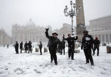 Shawn Roser, from Venice, Florida, a student at the North American college in Rome, throws a snowball as he plays in a snow blanketed St. Peter's Square at the Vatican, Monday, Feb. 26, 2018. (AP Photo/Alessandra Tarantino)