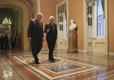 Senate Majority Leader Mitch McConnell, R-Ky., and Senate Minority Leader Chuck Schumer, D-N.Y., left, walk to the chamber after collaborating on an agreement in the Senate on a two-year, almost $400 billion budget deal that would provide Pentagon and domestic programs with huge spending increases, at the Capitol in Washington, Wednesday, Feb. 7, 2018. (AP Photo/Pablo Martinez Monsivais)