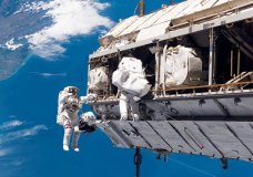 FILE - In this Dec. 12, 2006, file photo, made available by NASA, astronaut Robert L. Curbeam Jr., left, and European Space Agency astronaut Christer Fuglesang, participate in a space walk during construction of the International Space Station. Under President Donald Trump's 2019 proposed budget released, Monday, Feb. 12, 2018, U.S. government funding for the space station would cease by 2025. The government would set aside $150 million to encourage commercial development. (NASA via AP, File)
