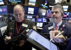 Traders Gordon Charlop, left, and John Panin work on the floor of the New York Stock Exchange, Tuesday, Feb. 6, 2018. The Dow Jones industrial average fell as much as 500 points in early trading, bringing the index down 10 percent from the record high it reached on Jan. 26. The DJIA quickly recovered much of that loss. (AP Photo/Richard Drew)
