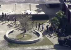In this frame grab from video provided by WPLG-TV, students from the Marjory Stoneman Douglas High School in Parkland, Fla., evacuate the school following a shooting there on Wednesday, Feb. 14, 2018. (WPLG-TV via AP)