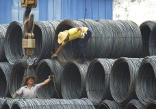 """In this Aug. 1, 2016 photo, laborers work in the steel market in Yichang in central China's Hubei province. China has expressed """"grave concern"""" about a U.S. trade policy report that pledges to pressure Beijing but had no immediate response to President Donald Trump's plan to hike tariffs on steel and aluminum. The Commerce Ministry said Friday, March 2, 2018, that Beijing has satisfied its trade obligations and appealed to Washington to settle disputes through negotiation.(Chinatopix Via AP, File)"""