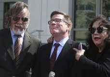 Defense attorney's Fritz Scheller, left, Charles Swift and Linda Moreno for Noor Salman react to a question during a news conference Friday, March 30, 2018 after the jury acquitted Noor Salman, Friday, March 30, 2018 in Orlando, Fla. Salman, widow of Omar Mateen, the gunman who slaughtered 49 people at a gay Orlando nightclub in 2016 was acquitted of helping to plot the attack and lying to the FBI afterward, a rare and stinging defeat for the U.S. government in a terrorism case. (Red Huber/Orlando Sentinel via AP)