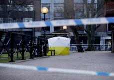 "A police tent is framed by police tape covering the the spot where former Russian double agent Sergei Skripal and his daughter were found critically ill Sunday following exposure to an ""unknown substance"" in Salisbury, England, Wednesday, March 7, 2018. Britain's counterterrorism police took over an investigation Tuesday into the mysterious collapse of the former spy and his daughter, now fighting for their lives. The government pledged a ""robust"" response if suspicions of Russian state involvement are proven. Sergei Skripal and his daughter are in a critical condition after collapsing in the English city of Salisbury on Sunday. (AP Photo/Matt Dunham)"