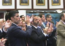 Rep. Jose Oliva, R- Miami Lakes, front, and other members of the Florida House, applaud Marjory Stoneman Douglas High School parent Andrew Pollack, who's daughter, Meadow Pollack, was killed in the school shooting, in Tallahassee, Fla., Wednesday, March 7, 2018. Oliva shepherd the bill through the House. (Scott Keeler/Tampa Bay Times via AP)