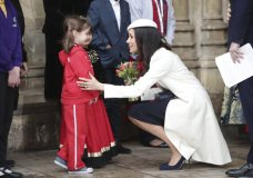 Meghan Markle talking to children as she leaves the Commonwealth Service at Westminster Abbey in London, Monday March 12, 2018. Organised by The Royal Commonwealth Society, the Commonwealth Service is the largest annual inter-faith gathering in the United Kingdom.(Yui Mok/PA via AP)