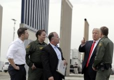 President Donald Trump reviews border wall prototypes, Tuesday, March 13, 2018, in San Diego. (AP Photo/Evan Vucci)