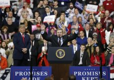Republican Rick Saccone, right, acknowledges the crowd during a campaign rally with President Donald Trump, Saturday, March 10, 2018, in Moon Township, Pa. Saccone is running against Democrat Conor Lamb in a special election being held on March 13 for the Pennsylvania 18th Congressional District vacated by Republican Tim Murphy. (AP Photo/Keith Srakocic)