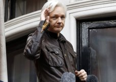 FILE - In this May 19, 2017 file photo, WikiLeaks founder Julian Assange greets supporters from a balcony of the Ecuadorian embassy in London. Ecuadorean officials announced Wednesday, March 28, 2018, that they are cutting off Assange's communications to the outside. Assange has been living in Ecuador's embassy for more than five years. (AP Photo/Frank Augstein, File)