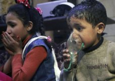 This image released early Sunday, April 8, 2018 by the Syrian Civil Defense White Helmets, shows a child receiving oxygen through respirators following an alleged poison gas attack in the rebel-held town of Douma, near Damascus, Syria. Syrian rescuers and medics said the attack on Douma killed at least 40 people. The Syrian government denied the allegations, which could not be independently verified. The alleged attack in Douma occurred Saturday night amid a resumed offensive by Syrian government forces after the collapse of a truce. (Syrian Civil Defense White Helmets via AP)