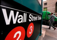 This April 5, 2018, photo shows a sign for a Wall Street subway station in New York. The U.S. stock market opens at 9:30 a.m. EDT on Thursday, April 12. (AP Photo/Richard Drew)