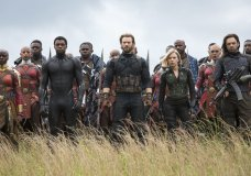 "FILE - This image released by Marvel Studios shows, front row from left, Danai Gurira, Chadwick Boseman, Chris Evans, Scarlet Johansson and Sebastian Stan in a scene from ""Avengers: Infinity War."" The Walt Disney Co. said Saturday that the Marvel superhero saga had earned just under $975 million in global box office through Friday. Since the film earned nearly $70 million on Friday alone, the studio is confident it will pass the billion-dollar mark on Saturday, in 11 days. (Chuck Zlotnick/Marvel Studios via AP)"