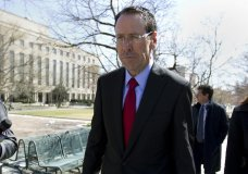 "FILE - In this March 22, 2018 file photo, AT&T CEO Randall Stephenson leaves the federal courthouse in Washington. Stephenson says the company made a ""big mistake"" in hiring President Donald Trump's attorney Michael Cohen as a political consultant. In an internal memo to employees, obtained by The Associated Press, Friday, May 11, Stephenson called the hiring a ""serious misjudgment,'"" and said that the company's chief lobbyist in Washington is leaving. (AP Photo/Jose Luis Magana)"