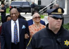 """FILE - In this April 24, 2018, file photo, Bill Cosby, left, arrives with his wife, Camille, for his sexual assault trial, at the Montgomery County Courthouse in Norristown, Pa. Bill Cosby's wife is calling for a criminal investigation into the prosecutor behind his sexual assault conviction, saying the case was """"mob justice, not real justice"""" and a """"tragedy"""" that must be undone. Camille Cosby commented on the case for the first time on Thursday, May 3, in statement issued through a spokesman a week after her husband of 54 years was convicted of aggravated indecent assault. (AP Photo/Matt Slocum, File)"""