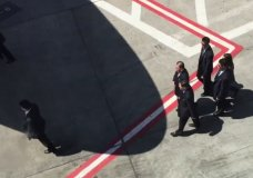 In this image made from video, Kim Yong Chol, center top, a senior North Korean official, walks across the tarmac at New York's John F. Kennedy International Airport upon his arrival Wednesday, May 30, 2018. Kim is in New York for talks with U.S. Secretary of State Mike Pompeo aimed at salvaging a summit between Kim Jong Un and President Donald Trump, in the North's highest-level mission to the United States in 18 years. (AP Photo/Joe Frederick)