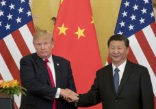 """FILE - In this Nov. 9, 2017 file photo, President Donald Trump and Chinese President Xi Jinping shake hands during a joint statement to members of the media Great Hall of the People in Beijing, China. The U.S. is announcing that it will impose a 25 percent tariff on $50 billion worth of Chinese goods containing """"industrially significant technology."""" The White House said Tuesday, May 29, 2018, that the tariff will cover goods related to the """"Made in China 2025"""" program. The full list of imports that will be covered will be announced by June 15. (AP Photo/Andrew Harnik, File)"""